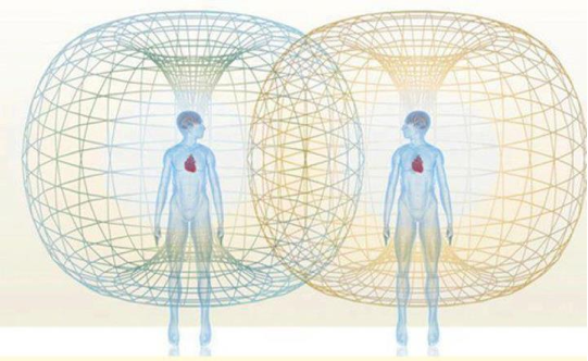 Two beings connected by an energetic field showing The Purpose of Relationships