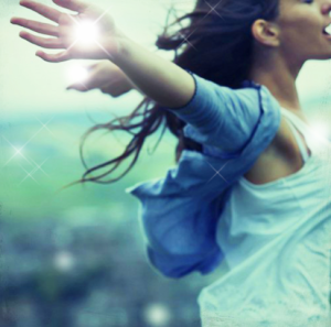 Woman soaring with arms thrown back demonstrating self empowerment