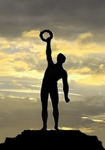 Silhouette of a man reaching up for a wreath demonstrating You Are Motivated By Pleasure
