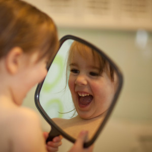 Baby looking in Mirror demonstrating What you put out is what you get back