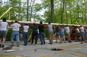 people raising barn frame